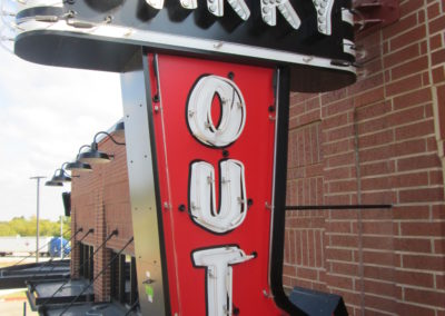 Carry Out Projecting Blade Sign